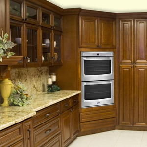 dark wooden colored cabinets with silver oven